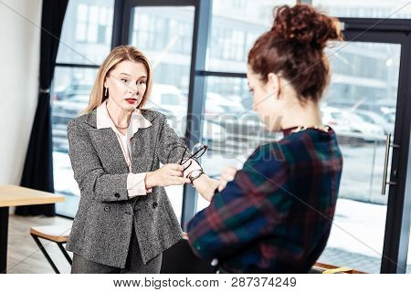 Strict Businesswoman Talking To Her Inexperienced Secretary