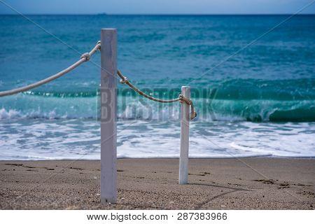 Rope Railing Leading To Calm Sea, Mediterranean Beachscape, Copyspace