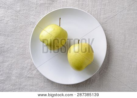 Imperfect Ugly Misshapen Fresh Golden Apples Rich In Vitamins Served On A Plate