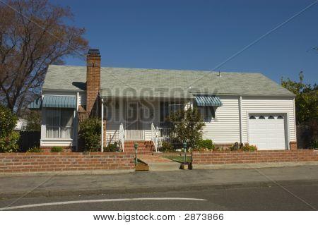 Older Single Car Modest Home