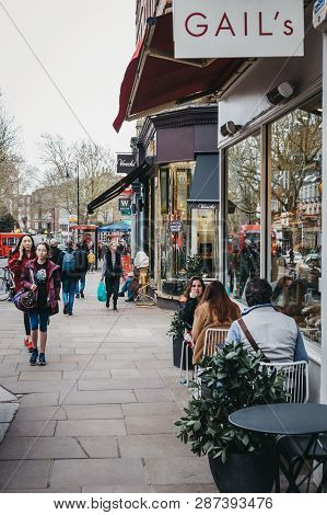 London, Uk - March 2, 2019: People Sitting At Outdoor Tables Of Gails Cafe In Hampstead, An Affluent