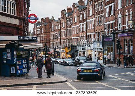 London, Uk - March 2, 2019: People By Hampstead Underground Station, London, Retail Shops On The Bac