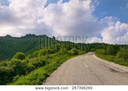 Lonely Road On The Mountain Landscape. Cycling In Nature On The Mountain. Cycling In Nature. Mountai