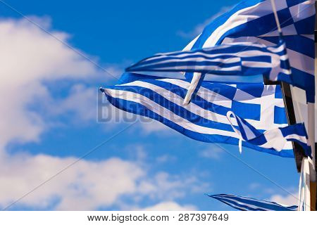 Greek Flags Waving Outdoor On Strings During Summer Weather. Greece European Country National Landma
