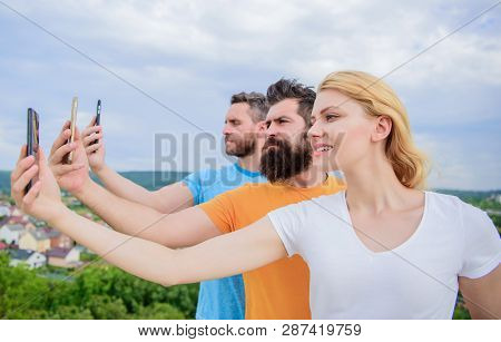 Experiencing Digital Picture Sharing. Best Friends Taking Selfie With Camera Phone. People Shooting