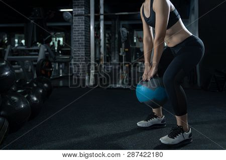 Woman Exercise Workout At Gym Fitness Training Sport With Kettlebells Weight Lifting And Legs Squat