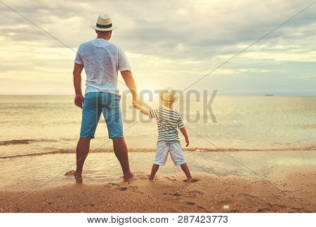 Happy Fathers Day. Family Dad And Child Son At Sea Beach