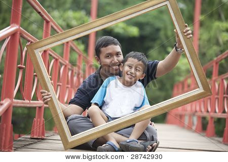 Father And Son With A Frame