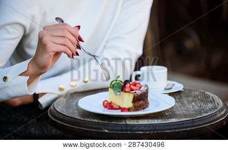 Appetite Concept. Dessert Cake Cup Of Coffee And Female Hand With Fork Close Up. Piece Of Cake With