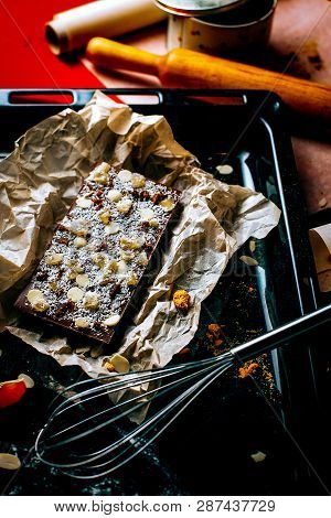 Homemade Chocolate Bar With Nuts, Coconut On Oven-tray