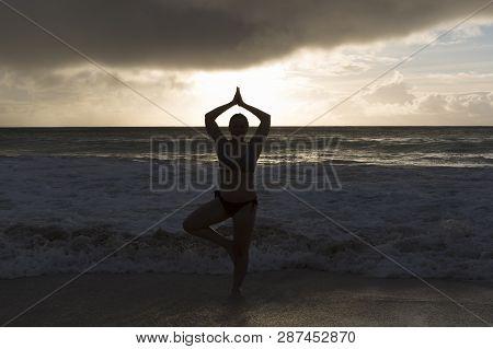 Beach Girl In The Ocean At Sunset