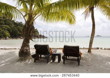 Tropical Landscape View With Deckchairs At Praslin Island, Seychelles