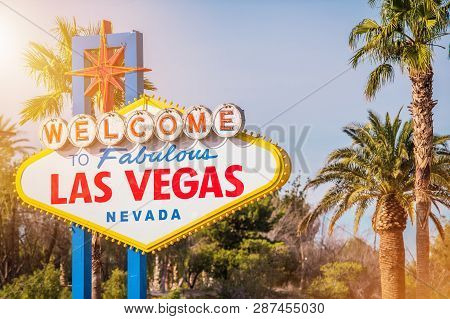 Las Vegas Welcome Sign Between Nevada Palm Trees. United States Of America. Famous Sin City Entrance