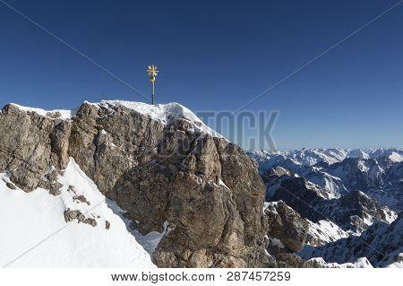 Golden Summit Cross At Zugspitze Bavaria, Top Of Germany, Wintertime, Panorama Shot