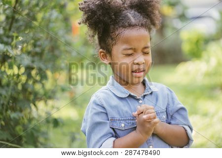 Little Girl Praying. Kid Prays. Gesture Of Faith.hands Folded In Prayer Concept For Faith,spirituali