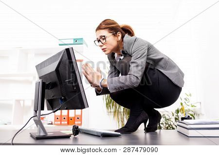 Business Woman Praying To Her Computer