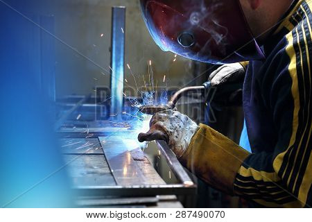 Work In A Workshop, Welding. The Man Works In The Workshop.