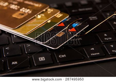 Credit Card Phishing Attack Over Dark Background, Close-up