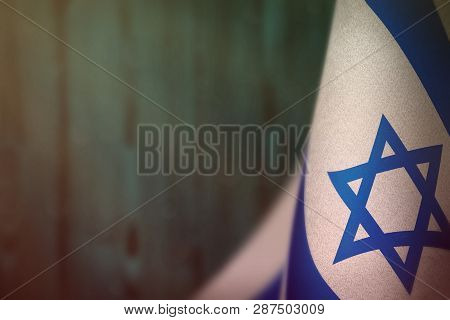 Israel Hanging Flag For Honour Of Veterans Day Or Memorial Day On Light Blue Blurred Natural Wood Wa