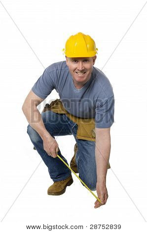 Kneeling Construction Worker Smiles