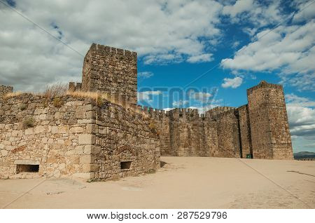 Towers And Stone Walls Facade At The Castle Of Trujillo