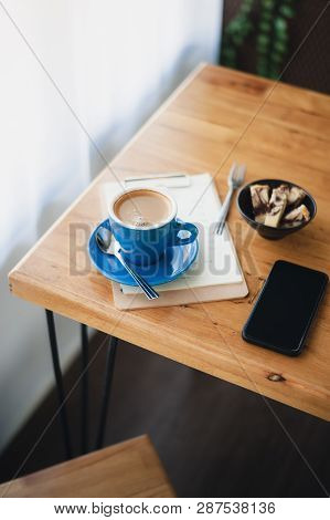 Abstract Emotional Scene Of Hot Long Black (americano) In Blue Coffee Cup On Table At Cafe In Mornin