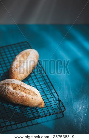 Baguette, European Style Bread On Blue Wood Table In Morning Time With Hard Light Effect. Organic An