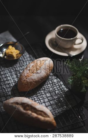 Baguette, European Style Bread With Margarine And Black Coffee On Black Wood Table In Early Morning