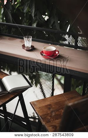 Abstract Emotional Scene Of Hot Coffe In Red Coffee Cup On Table At Cafe In Morning Time. Weekend Ac