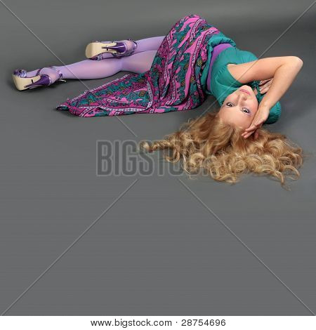 Young Girl Lying In The Casual Pose