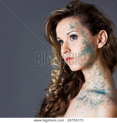 Sensual Young Woman With Creative Make-up And Long Brown Curly Hair