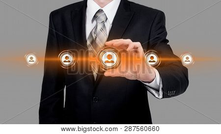 Human Resource Business Concept. Businessman Presses Hr Icon On Virtual Screen