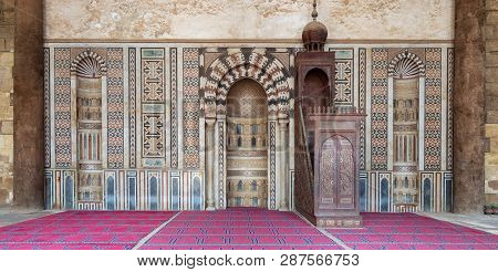 Colorful Decorated Marble Wall With Engraved Mihrab (niche) And Wooden Minbar (platform) At The Publ