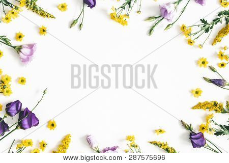Flowers Composition. Yellow And Purple Flowers On White Background. Spring, Easter Concept. Flat Lay