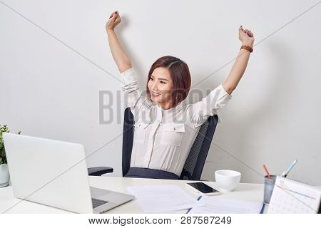Satisfied Woman Relaxing With Hands Behind Her Head. Happy Smiling Employee After Finish Work, Readi