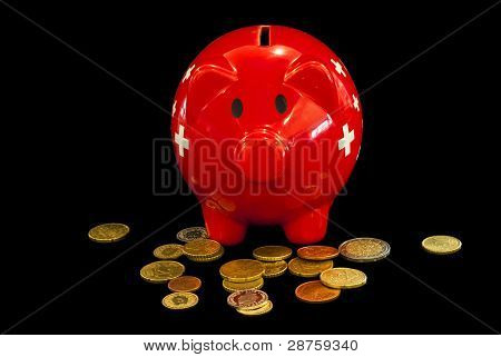 Piggy Bank And Some Coins Issolated On Black Background