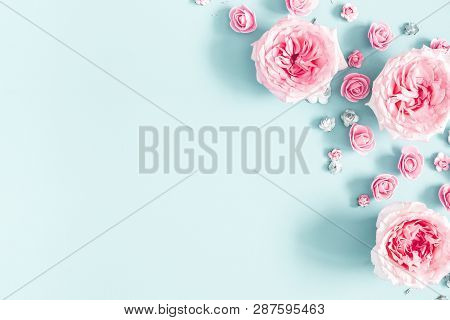 Flowers Composition. Frame Made Of Rose Flowers On Pastel Blue Background. Valentines Day, Mothers D