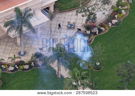 Cairo, Egypt - February 25, 2010: Spraying Mosquitoes With Insecticide At Garden In Cairo, Egypt.