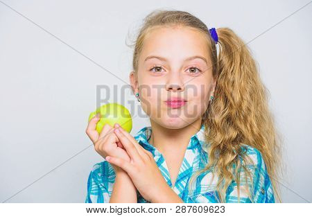 Good Nutrition Is Essential To Good Health. Kid Girl Eat Green Apple Fruit. Nutritional Content Of A