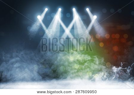 Tile Floor With Concert Spot Lighting And Smoke With Defocused Colorful Lights Background