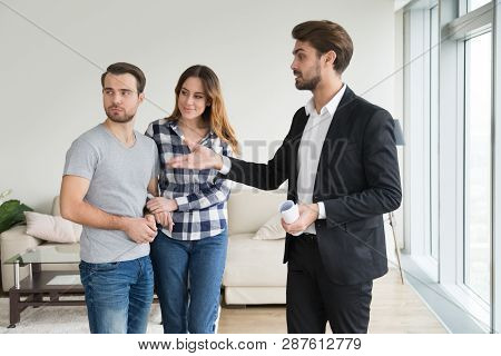 Realtor Or Landlord Showing House Apartment To Young Couple