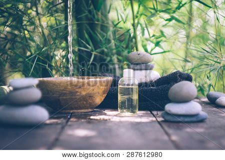 Spa Background With Woman's Hands And Clear Water On An Old Wooden Table. Japanese Style. Simplicity