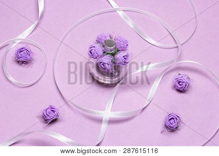 Perfume Spray Bottle With Small Lilac Roses And White Satin Ribbon. Fragrance As Gift For Woman