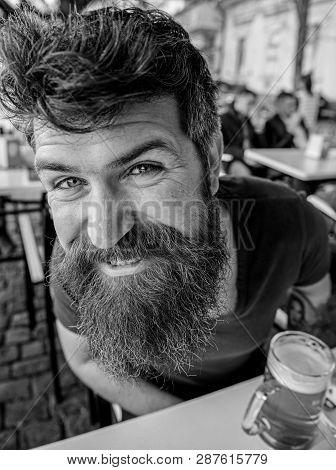 Guy Having Rest With Cold Draught Beer. Hipster On Happy Face Drinking Beer Outdoor. Man With Beard