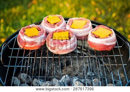Making Home Made Beer Can Bacon Burgers On Barbecue Grill.
