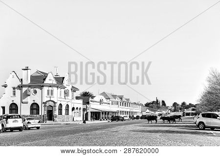 Winburg, South Africa, July 30, 2018: A Street Scene With Businesses, People And Vehicles, In Winbur