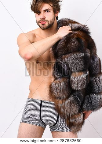 Guy Attractive Posing Fur Coat On Naked Body. Luxury Lifestyle And Wellbeing. Luxury Status Symbol.