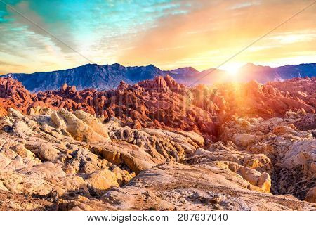 Amazing colors and shape of the sun setting over rocks in Fire Canyon, Valley of Fire State Park, Nevada, USA