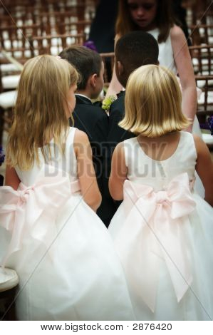 Ring Bearers And Flower Girls Rehearsing Walking Down The Isle A