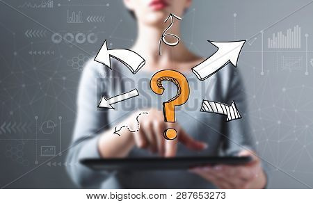 Question Mark With Arrows With Business Woman Using A Tablet Computer
